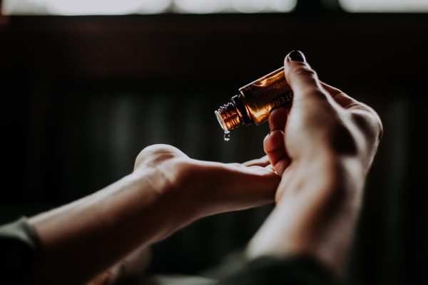 essential oils _oil pouring into hand