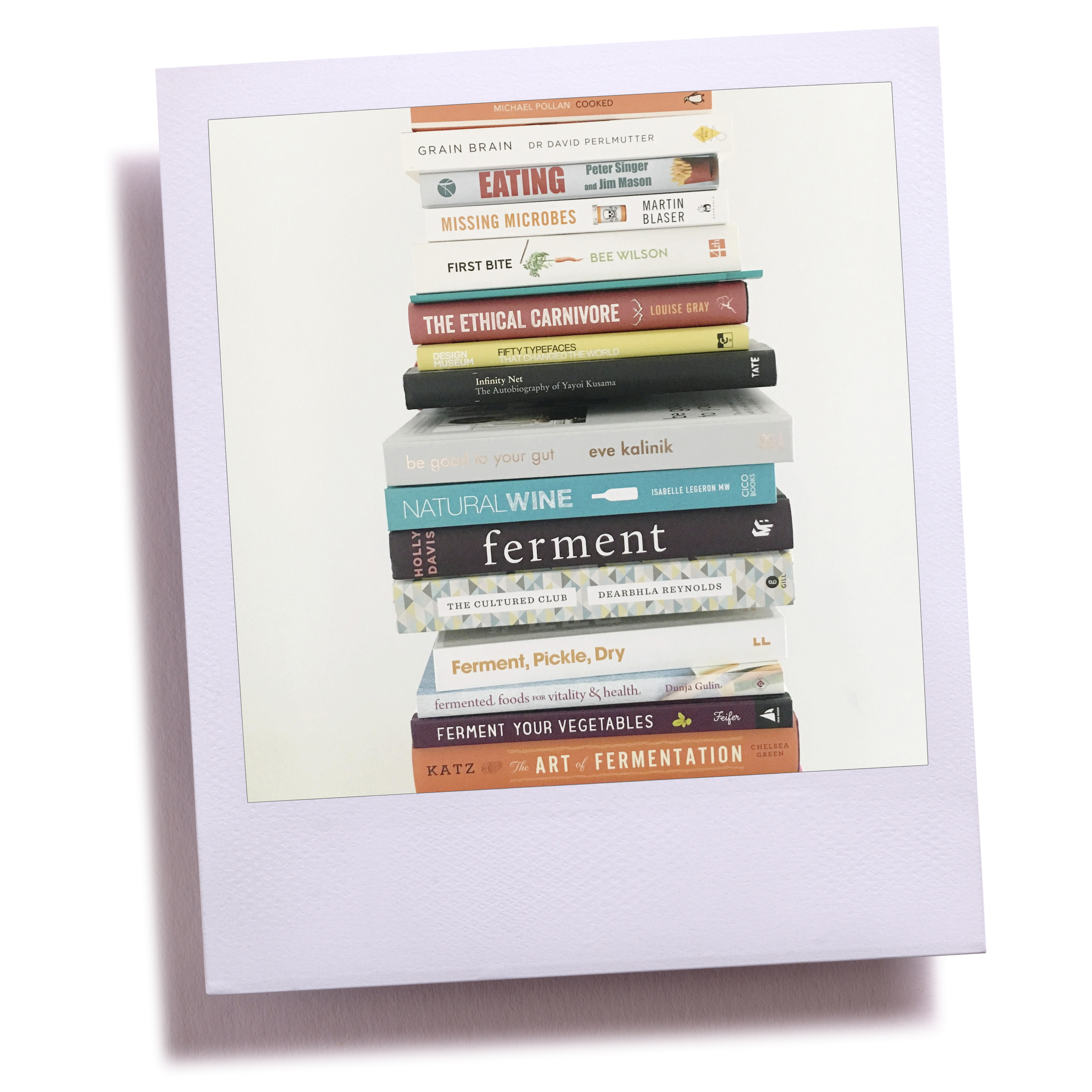 The to read pile of books from London nutritionist Eve Kalinik | Frame by Kstudio